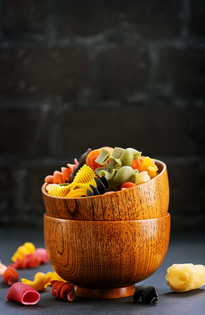 color pasta in bamboo bowls and on a table