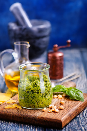 pesto sauce in glass and on a table