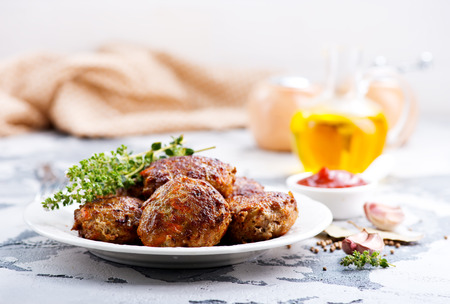 meatballs on plate and on a table
