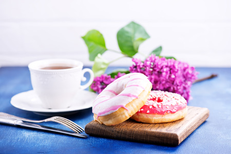 donuts on wooden board and on a table Stock Photo - 81264113