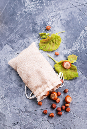 hazelnuts in bag and on a table
