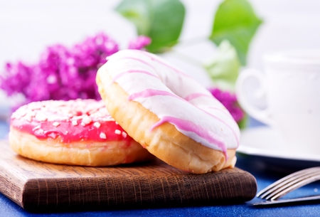 donuts on wooden board and on a table Stock Photo - 81220762