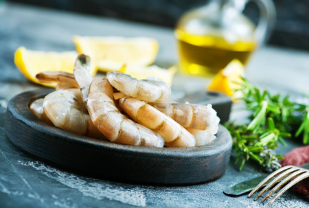 shrimps on wooden board and on a table