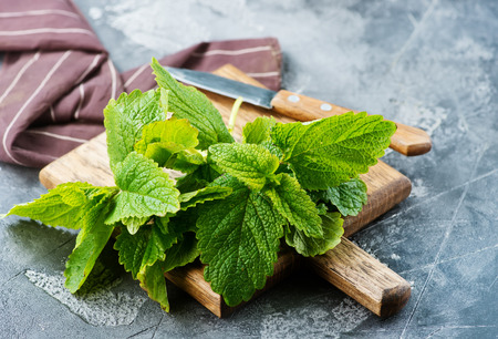 fresh mint on board and on a table Imagens
