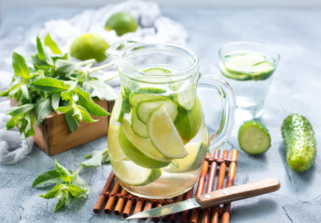 drink with lemon and cucumber in the jug