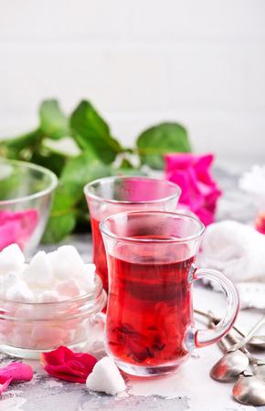 tea with rose on a table, stock photo Stock Photo