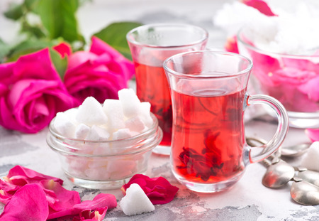 tea with rose on a table, stock photo Banco de Imagens