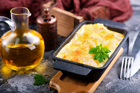 roasting pan: baked cauliflower with egg and cheese Stock Photo