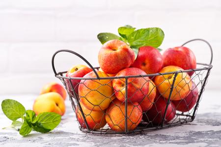 nektarins in metal basket and on a table Stock fotó
