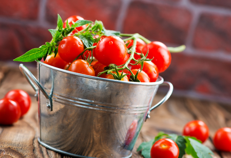 tomato cherry in bowl and on a table
