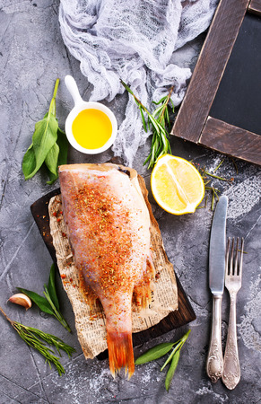 raw fish with aroma spice and salt
