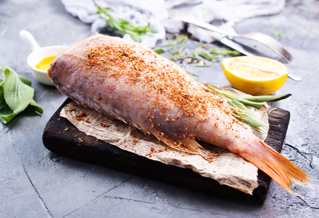 raw fish with spice and salt on a table Reklamní fotografie - 81872041