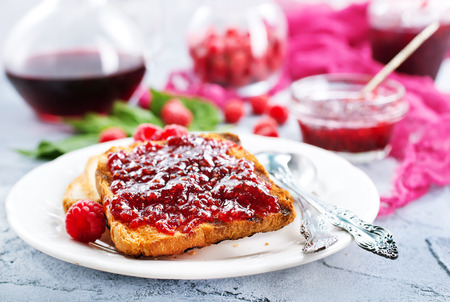 toasts with raspberry jam on the plate