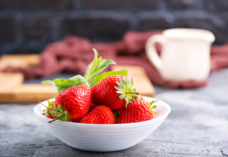 strawberry in bowl and on a table Stock Photo