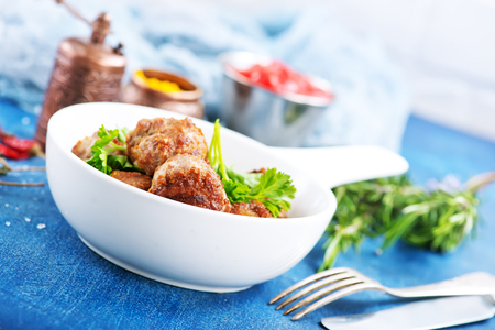 meatballs in bowl and on a table