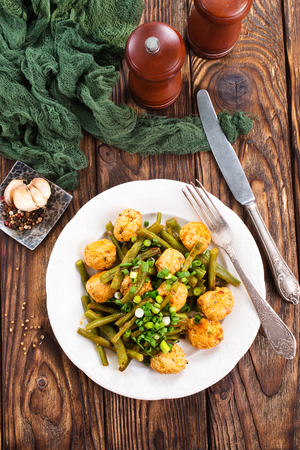 meatballs with green beans on the plate Stock Photo