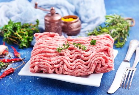 minced meat on plate and on a table Stock Photo
