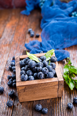 blueberry in wooden box and on a table