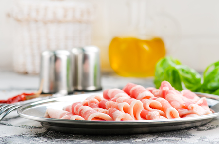bacon with spice on the metal plate, stock photo Stok Fotoğraf