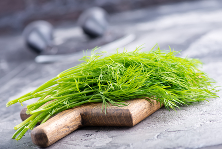 fresh dill on board and on a table Stock fotó