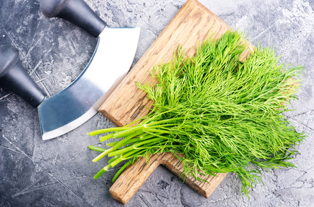 fresh dill on board and on a table Banco de Imagens