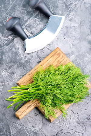 fresh dill on board and on a table Banco de Imagens - 82999522