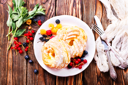 cakes with cream and berries on plate