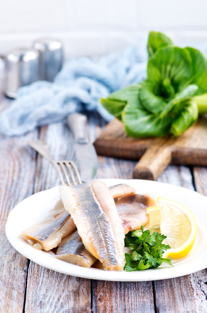 raw fish fillet and lemon on the plate Stock Photo
