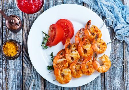 fried shrims with tomato sauce and lemon