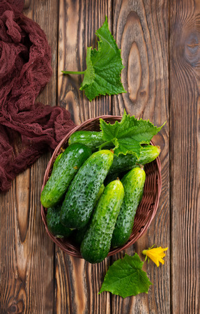 cucumbers in basket and on a table