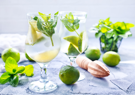 cocktail mixer: fresh mojito in glass and on a table