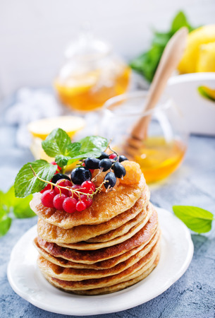 pancakes on white plate and on a table