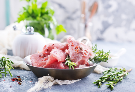 old desk: raw meat with oil and spice on a table Stock Photo