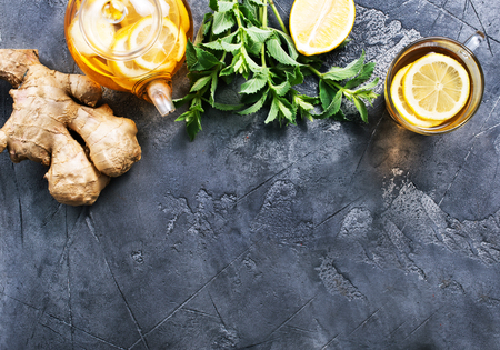 fresh ginger,herb and tea on a table