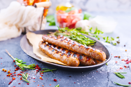 grill: sausages on plate and on a table Stock Photo