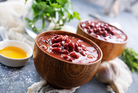 red bean with sauce in bowl and on a table