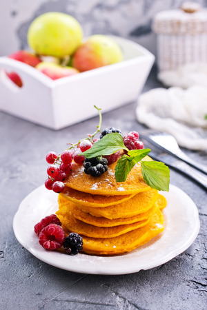 sweet pancakes with berries on the plate