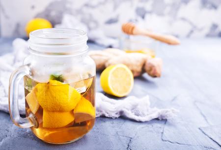 lemonad with fresh lemon and ginger on a table