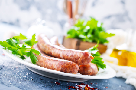 sausages with spice on white plate. stock photo