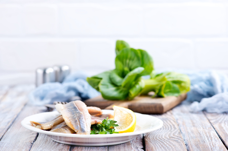 raw fish fillet and lemon on the plate Stock Photo - 83875092