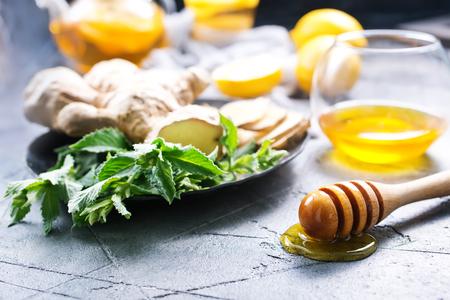 honey,fresh mint and lemons on a table Stock Photo