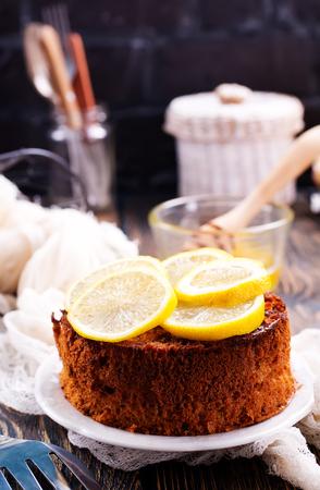 lemon pie with fresh lemons on a table