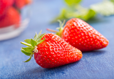 fresh strawberry on blue table, stock photo