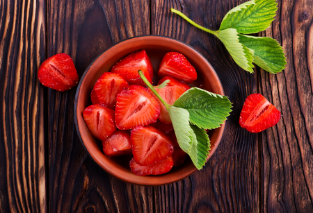 fresh strawberry on plate and on a table