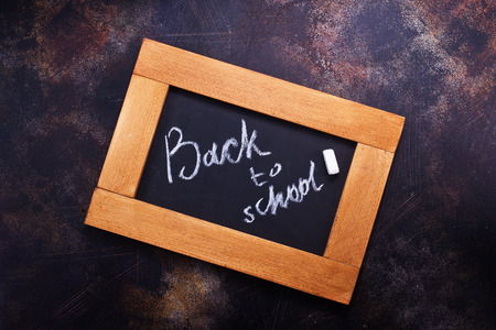 small chalkboard on a table, school supplies