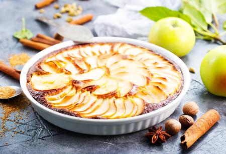 apple pie with cinnamon on a table