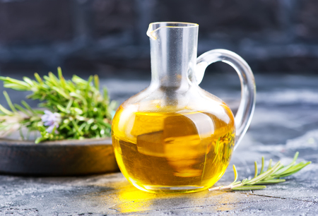 woman bath: herbal oil in jug and on a table