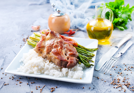 boiled rice with meat and green asparagus Фото со стока