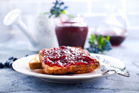 toasts and blueberry jam for the breakfast