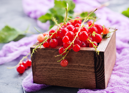 red currant in wooden box,stock photo